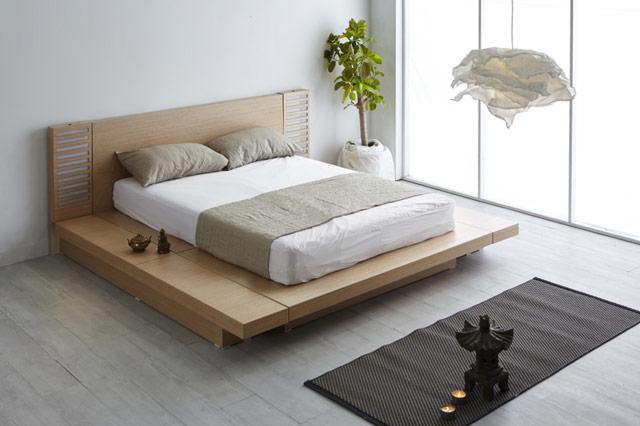 Nowoczesna, jasna, minimalistyczna sypialnia urządzona wstylu japońskim.